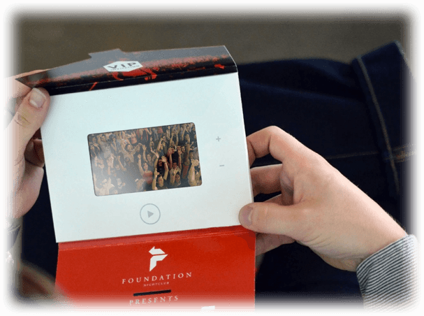 Guy Holding Interactive Pro Video Intorduction Card